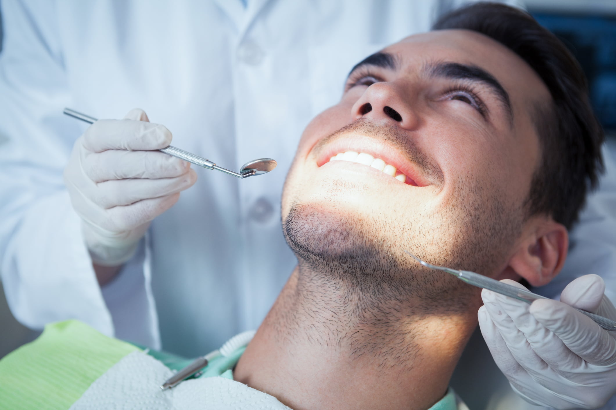 Close up of man having his teeth examined | Dentist Downtown Calgary | Eau Claire Park Dental